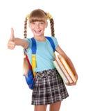 Livres de fixation d'écolière et pouce d'apparence vers le haut. image libre de droits