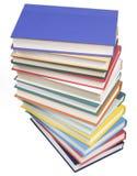 Livres empilés sur le blanc Images libres de droits