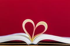 Livres et marque de coeur Photographie stock