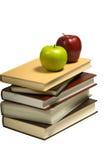 Livres et pommes d'école image stock