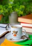 Livres et thé Photo stock