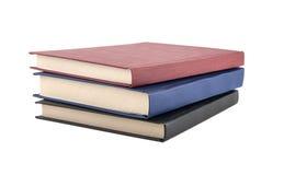 Livres reliés rouges, bleus et noirs Images stock
