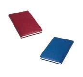 Livres rouges et bleus Photos stock