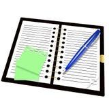 Livret-machine et crayon lecteur Photo stock