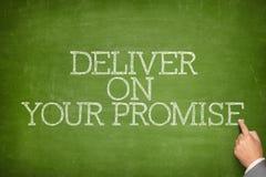 Livrez sur votre texte de promesse sur le tableau noir photo libre de droits