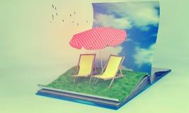 Livro aberto com sunbeds no campo de grama Fotografia de Stock Royalty Free