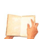Livro aberto do grunge da mão masculina isolado no branco Fotos de Stock