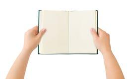 Livro aberto nas mãos Fotografia de Stock Royalty Free