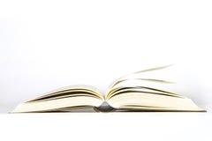 Livro aberto no fundo branco fotografia de stock