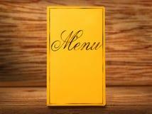 Livro amarelo do menu Imagens de Stock
