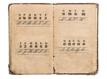Livro antigo do alfabeto fontes do vintage Conceito da instrução Foto de Stock