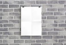 Livro Branco na parede cinzenta do birck Fotografia de Stock