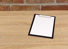 Livro Branco na tabela Imagem de Stock