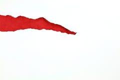 Livro Branco rasgado com papel vermelho para dentro Fotografia de Stock