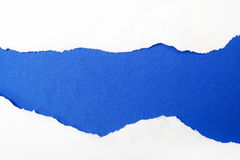 Livro Branco rasgado no fundo azul Cocept para o dia da conscientização do autismo Barreiras da ruptura junto para o autismo Fotos de Stock Royalty Free