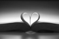 Livro com a forma do amor Fotografia de Stock Royalty Free