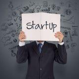 Livro da mostra da mão do homem de negócios do negócio startup Foto de Stock