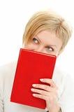 Livro da tampa da mulher da face Fotografia de Stock