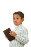 Livro da terra arrendada do menino Imagem de Stock Royalty Free
