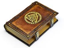 Livro de couro do vintage com o símbolo de Odin dourado, cercado com runas imagens de stock