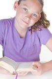 Livro de leitura da menina Foto de Stock Royalty Free