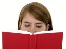 Livro de leitura da menina Imagem de Stock