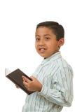 Livro de leitura do menino Imagem de Stock