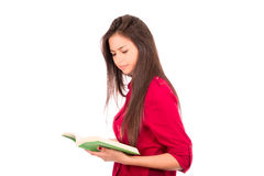 Livro de leitura latino novo da menina Foto de Stock Royalty Free