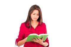 Livro de leitura latino novo da menina Fotos de Stock Royalty Free