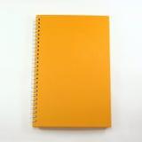 Livro de nota alaranjado da tampa Imagem de Stock