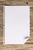 Livro de nota na madeira do grunge Foto de Stock Royalty Free