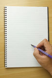 Livro de nota na tabela Foto de Stock