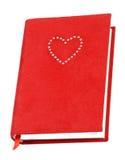 Livro de texto vermelho Fotos de Stock Royalty Free
