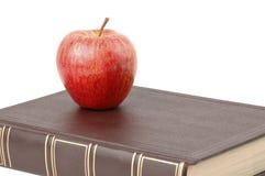 Livro e Apple fotos de stock