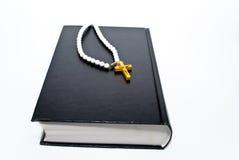 Livro e cruz Imagem de Stock Royalty Free