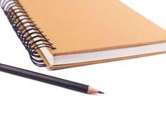 Livro e lápis imagens de stock royalty free