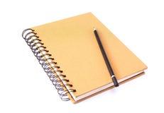 Livro e lápis foto de stock