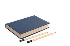 Livro e lápis. Imagem de Stock