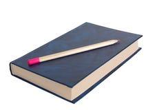 Livro e lápis. Fotografia de Stock
