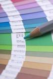 Livro e lápis do Swatch imagens de stock royalty free