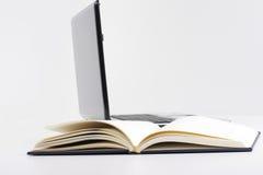 Livro e portátil Imagem de Stock Royalty Free