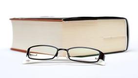 Livro e vidros grossos Imagens de Stock