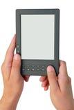 Livro eletrônico nas mãos Fotos de Stock Royalty Free