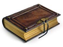 Livro encadernado de couro marrom envelhecido com curvatura do metal e bordas de papel douradas foto de stock royalty free