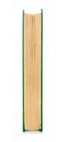 Livro fechado na tampa verde ao lado Imagem de Stock