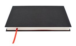 Livro negro com um marcador vermelho Fotos de Stock