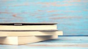 Livro no fundo de madeira azul Imagem de Stock Royalty Free