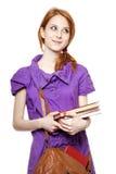 Livro Red-haired do sustento da menina à disposicão. foto de stock royalty free