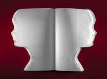 Livro velho dado forma como uma cara fotografia de stock royalty free