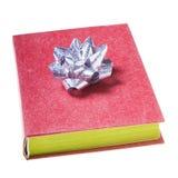 Livro vermelho com curva de prata Fotografia de Stock Royalty Free